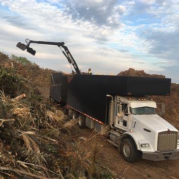 Truck picking up Debris